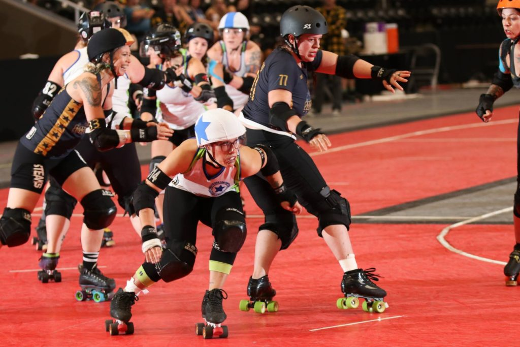Jammer Bazinga skates out of the pack vs. Tucson at the WFTDA Continental Cup